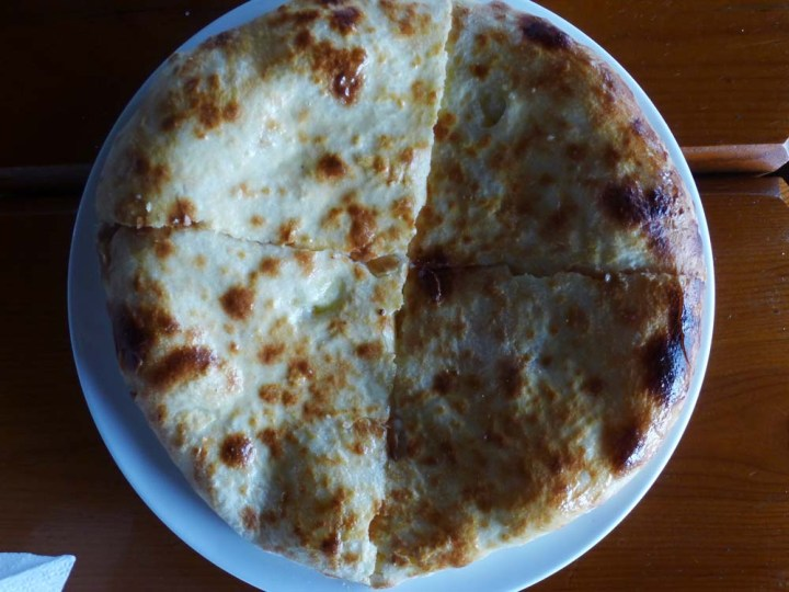 """Khachapuri"" chewy,  Georgian pizza with ""Sulguni"" a local salty, stinky, melty cheese."